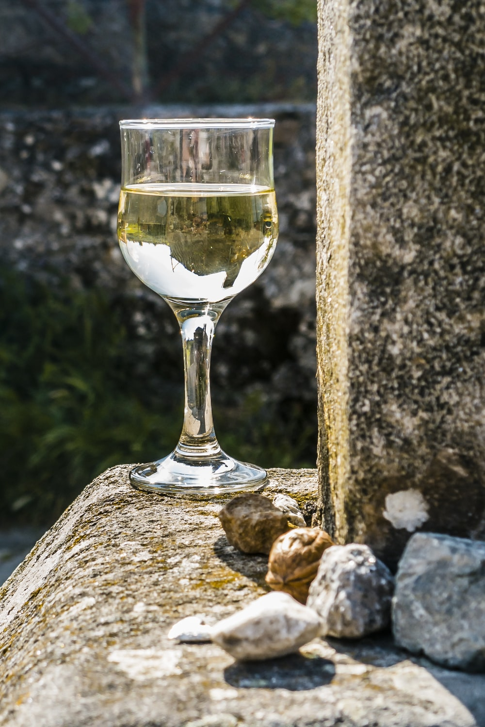 clear wine glass on brown rock