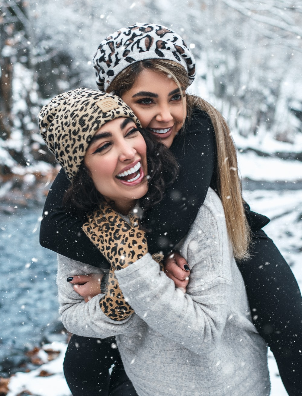 woman in gray coat and leopard scarf smiling