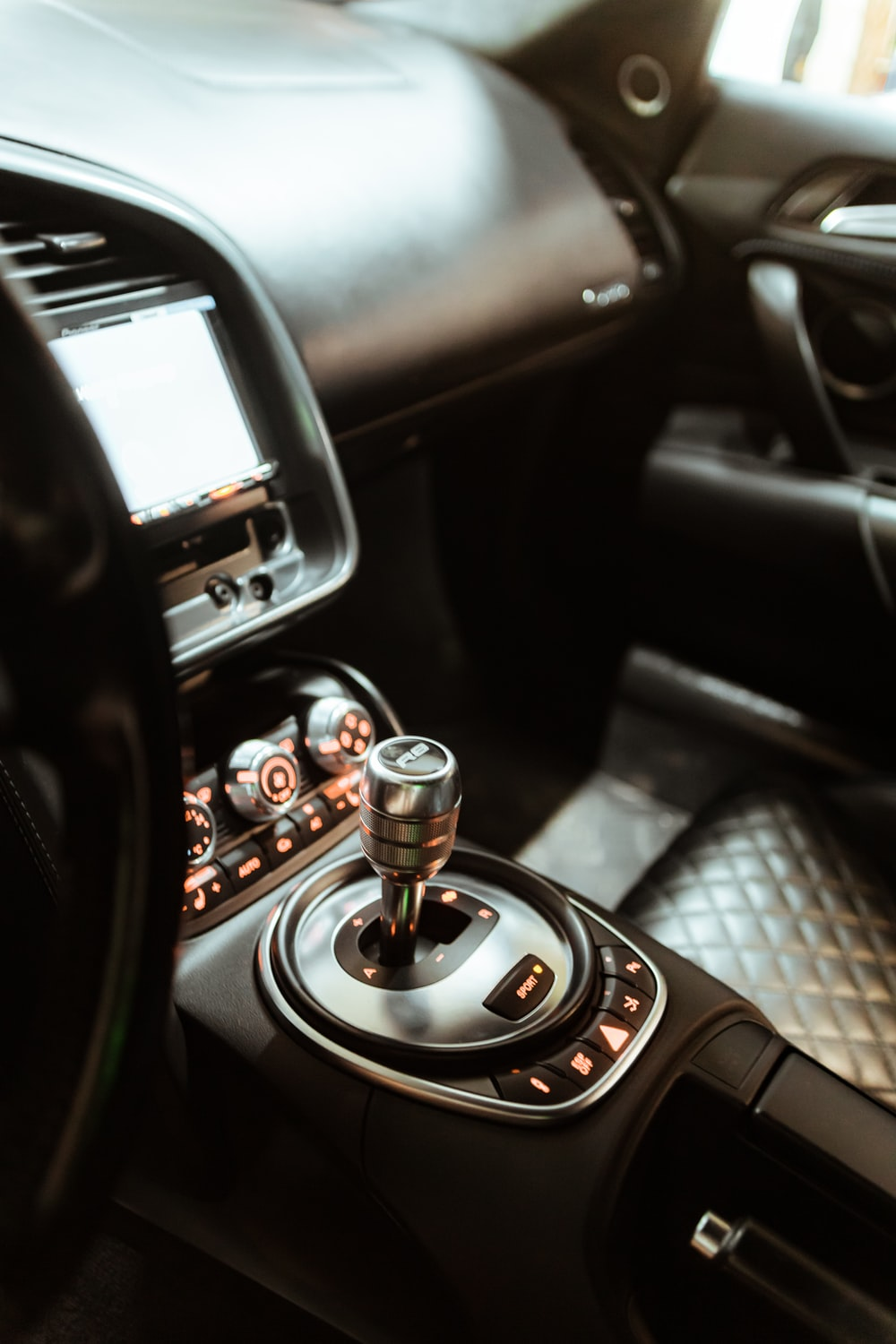 black and silver car gear shift lever