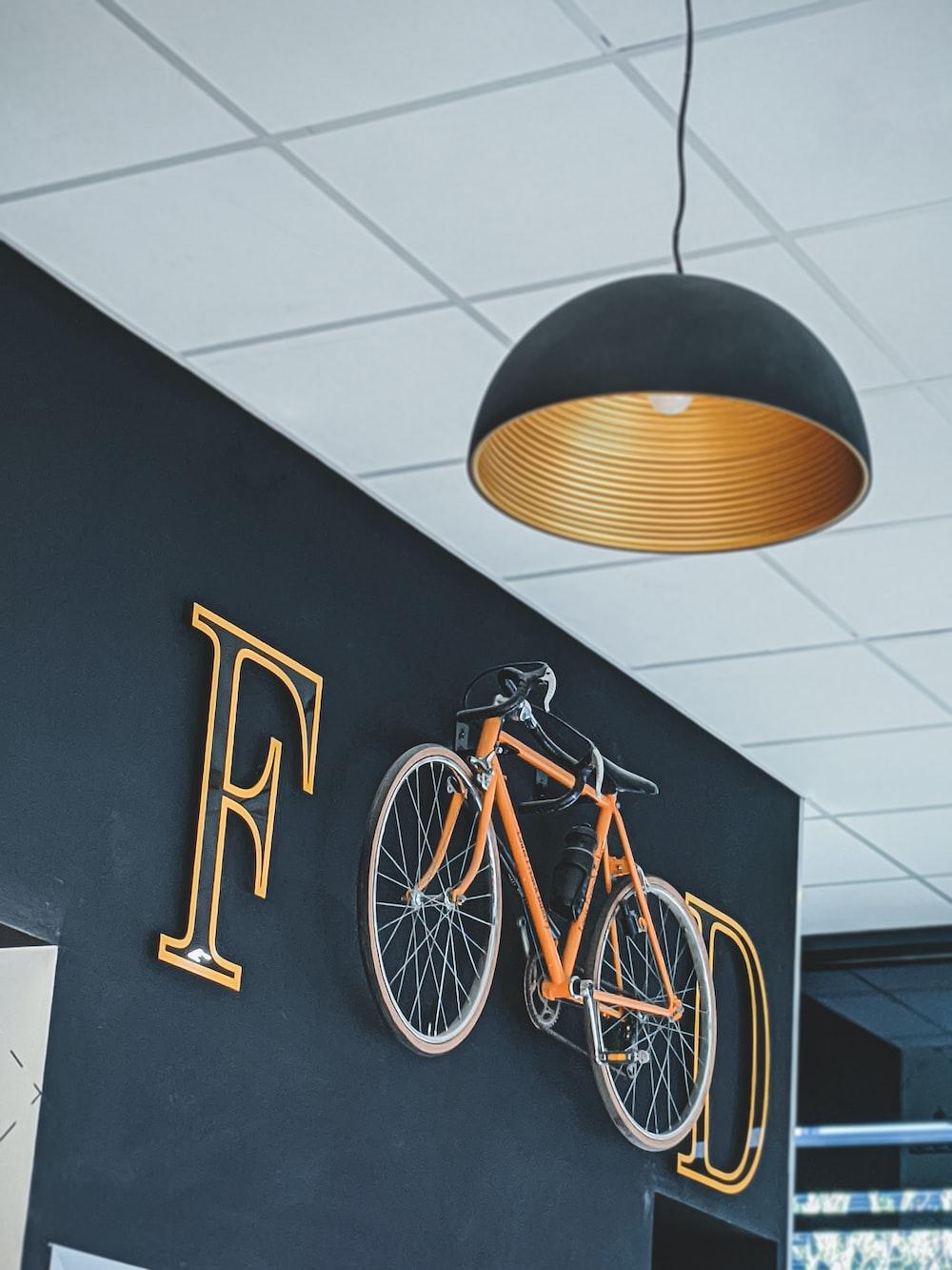 yellow city bike on white floor tiles