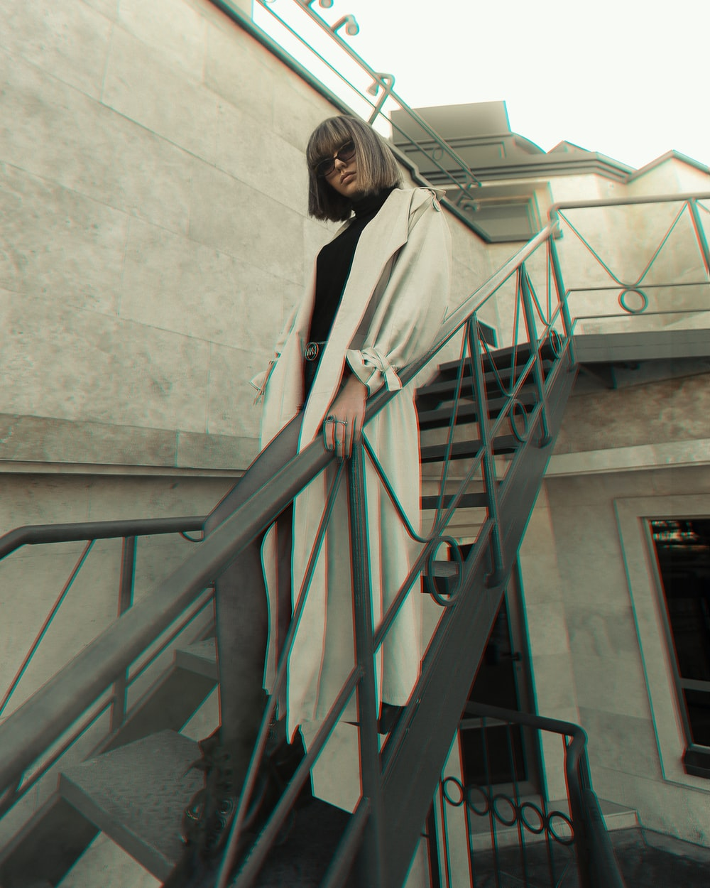 woman in white long sleeve shirt standing on stairs