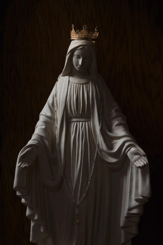 man in white robe statue