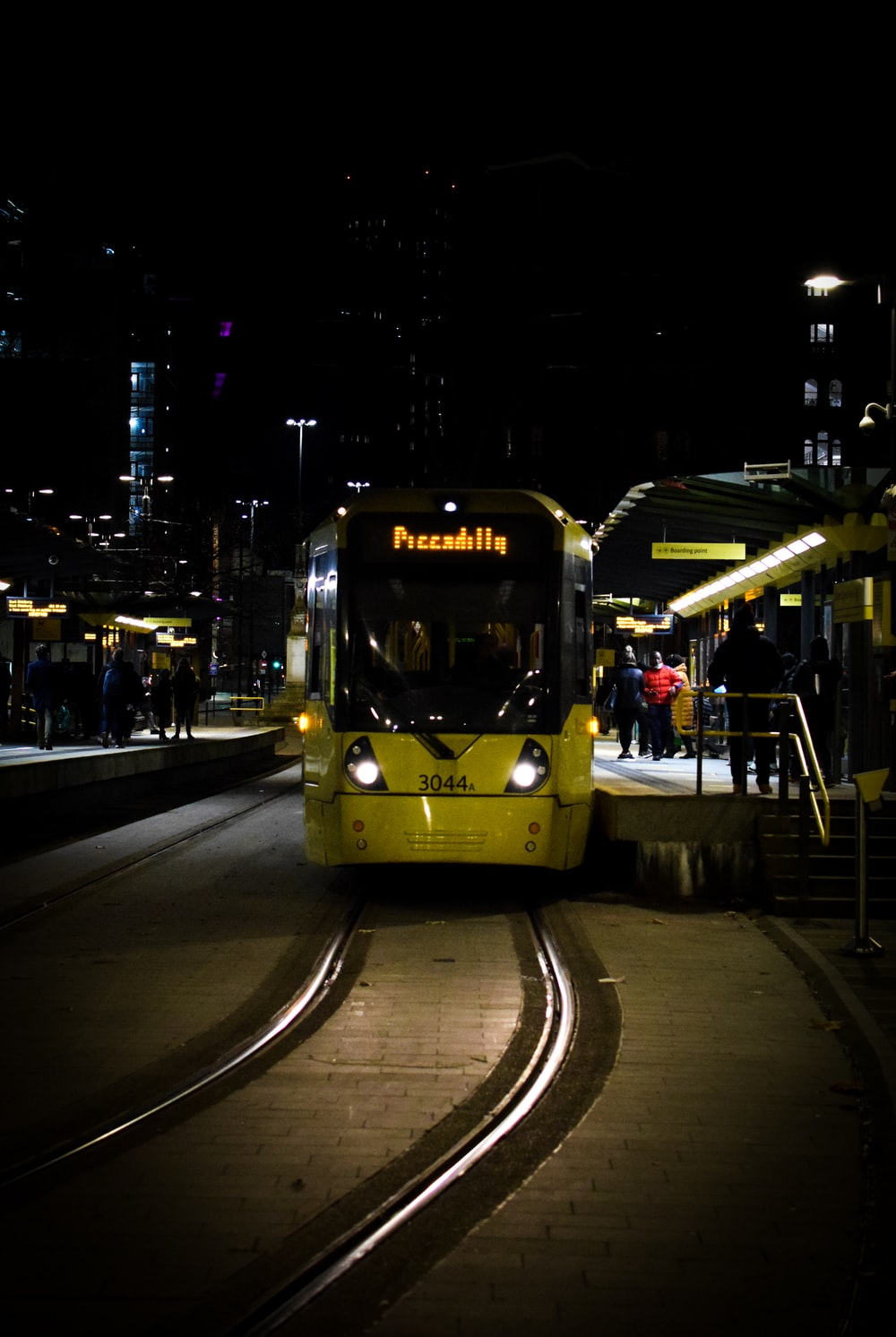 yellow tram on road during night time