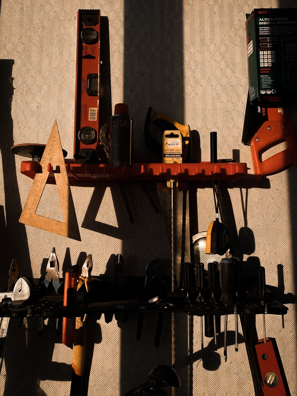 assorted color power tools on wall