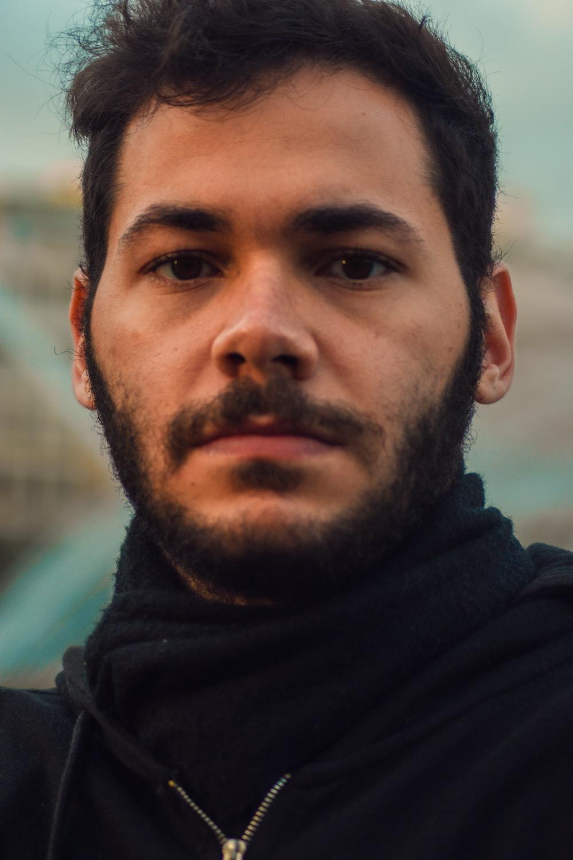 man in black hoodie during daytime