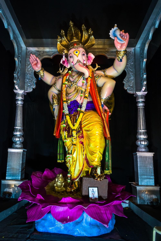 hindu deity figurine on table
