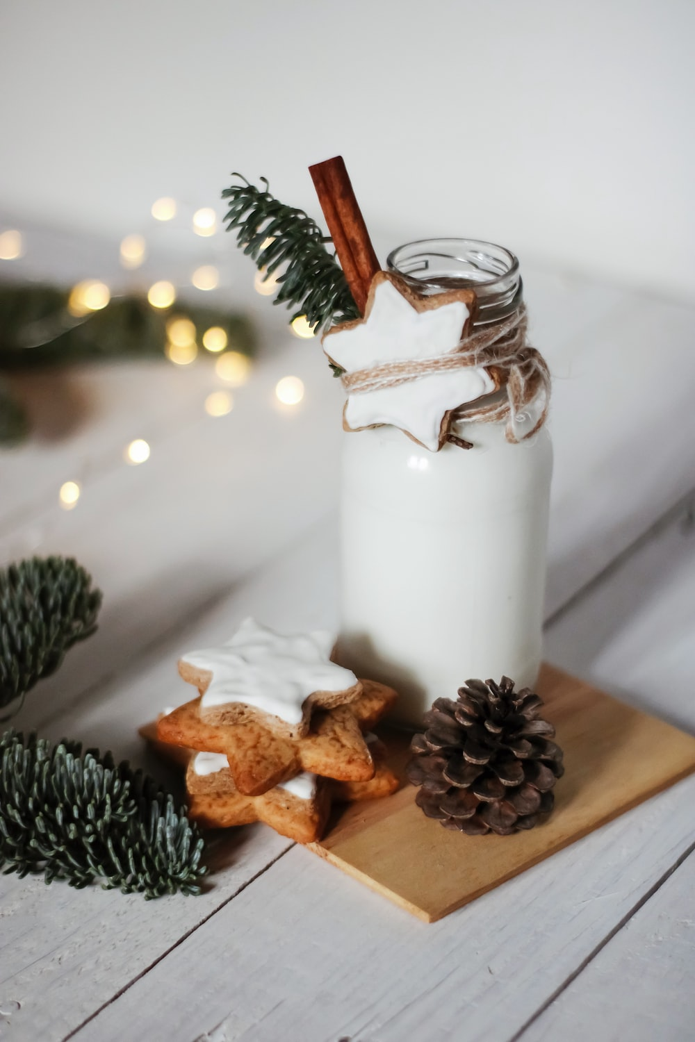 brown pine cone and white pillar candle