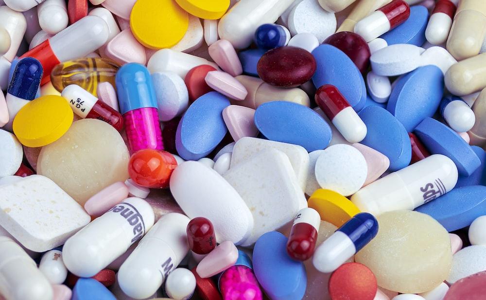 white blue and orange medication pill