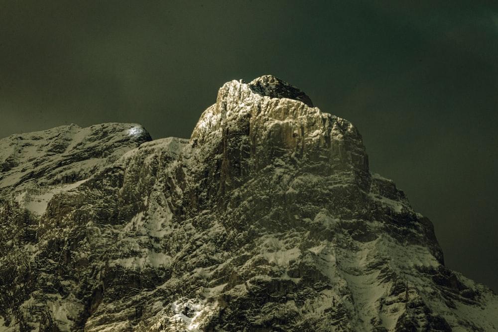 gray rocky mountain under gray sky