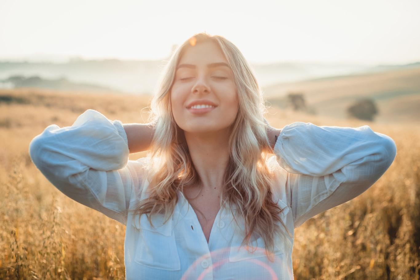 woman in white dress shirt smiling