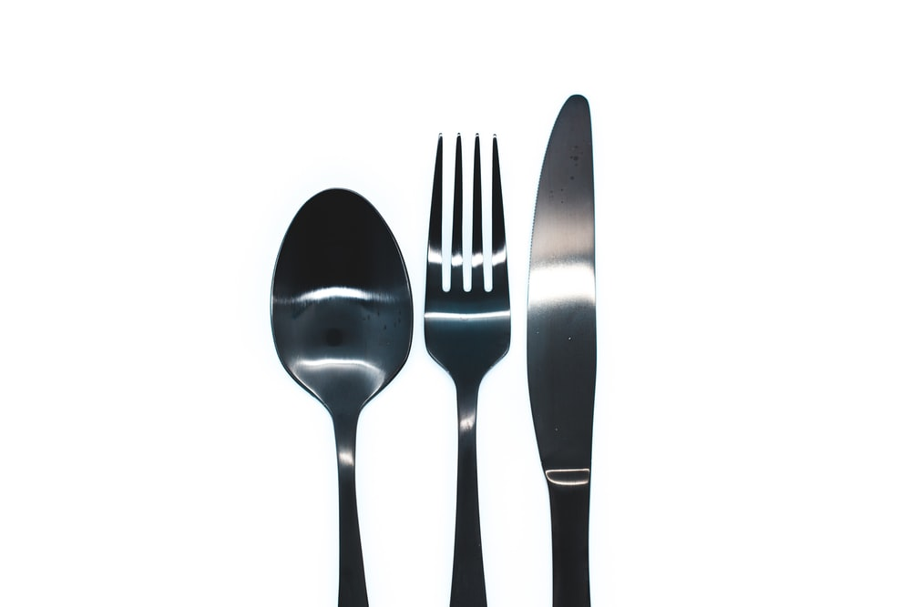 silver spoon and fork on white background