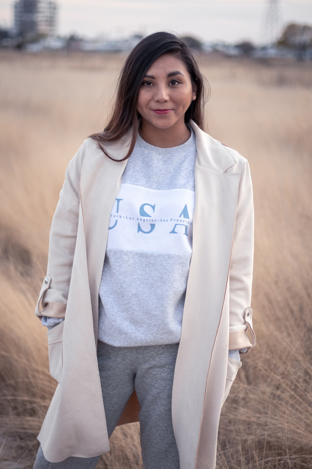 woman in white coat and gray shirt