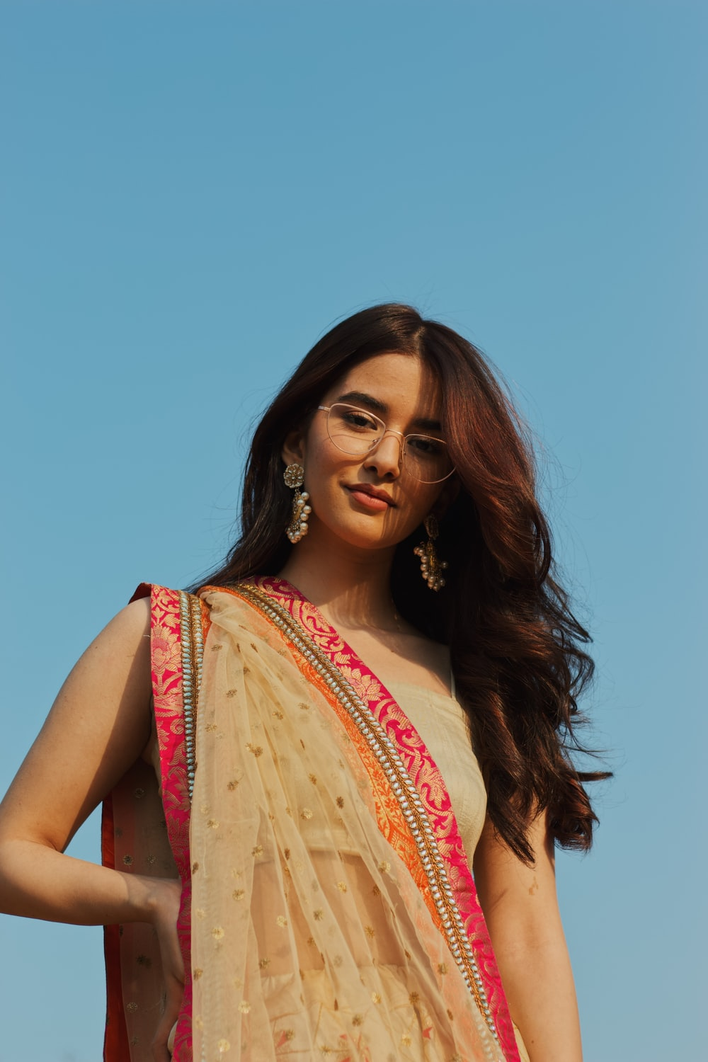 woman in pink and beige sari