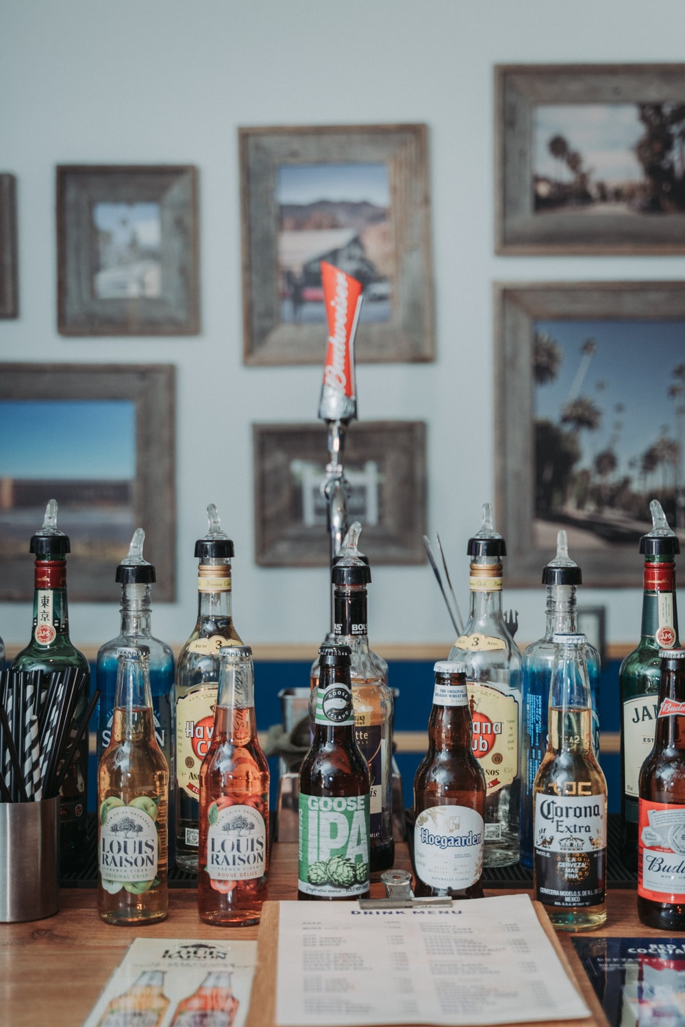assorted glass bottles on table