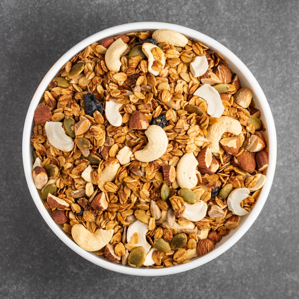 white ceramic bowl with brown nuts