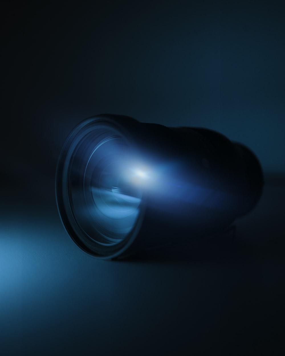 blue light bulb turned on in dark room