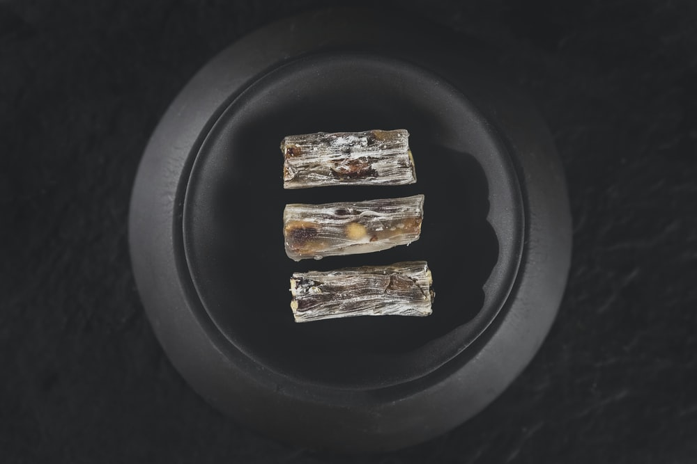 2 brown and white food on black plate