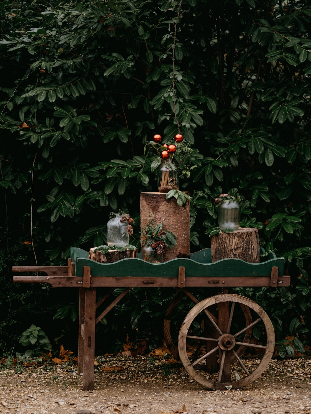 red and brown wooden cart with candle on top