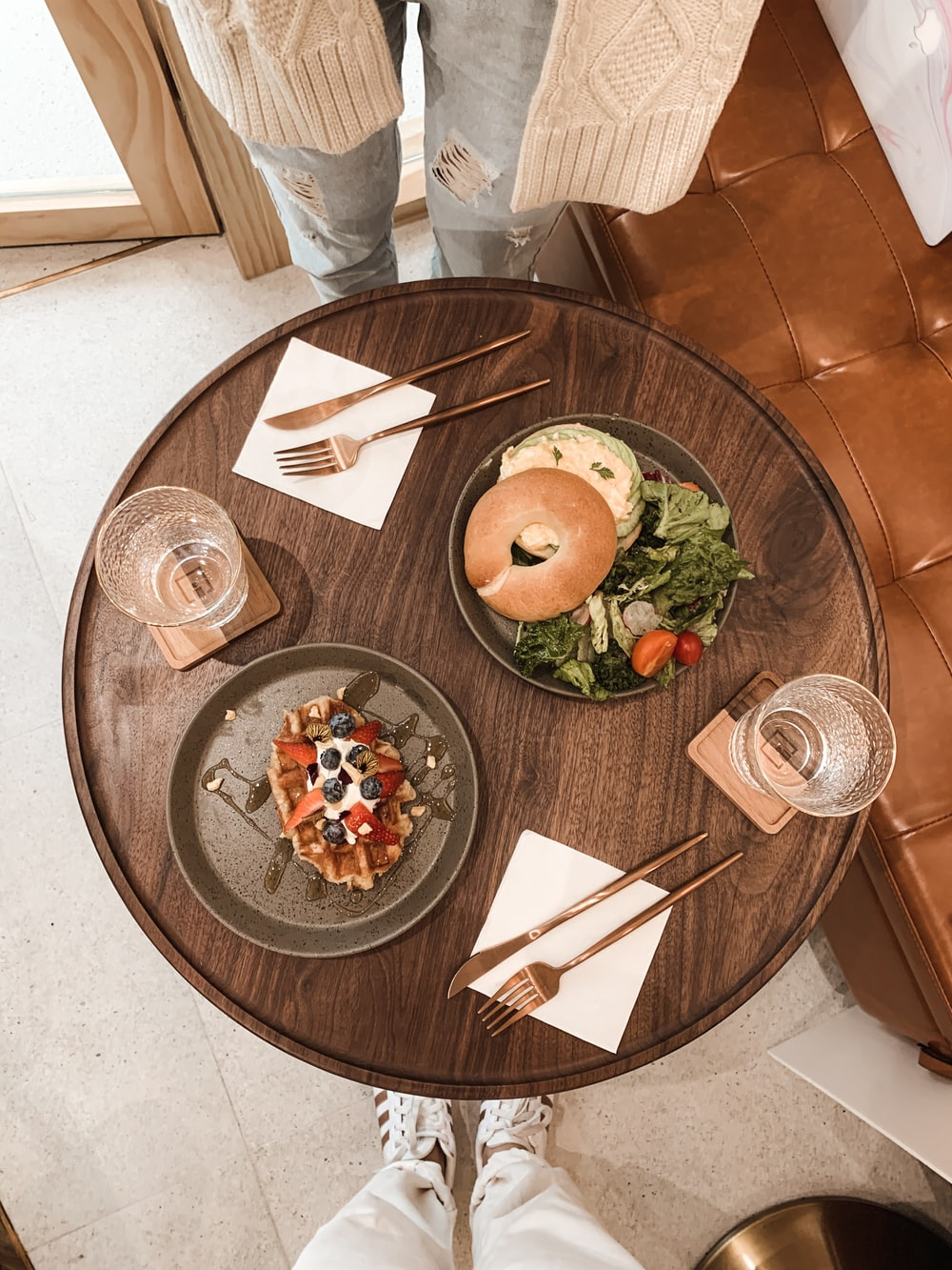 brown round plate with foods on table
