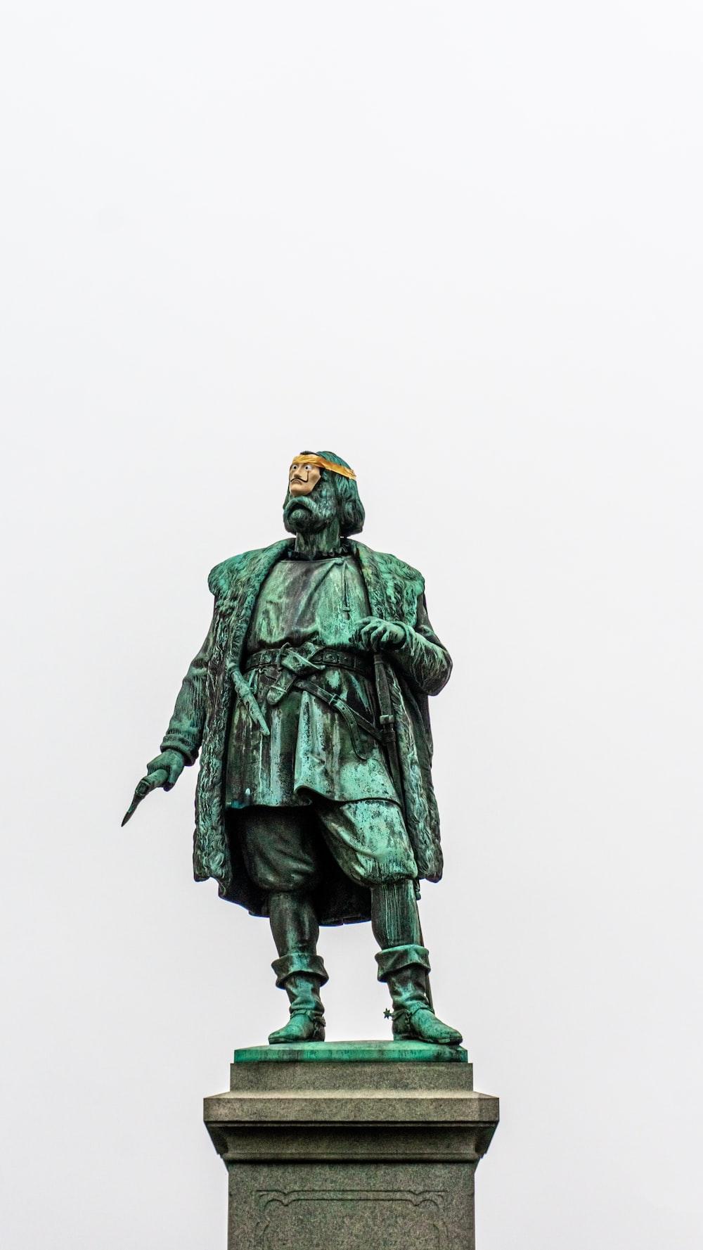 man in green coat statue