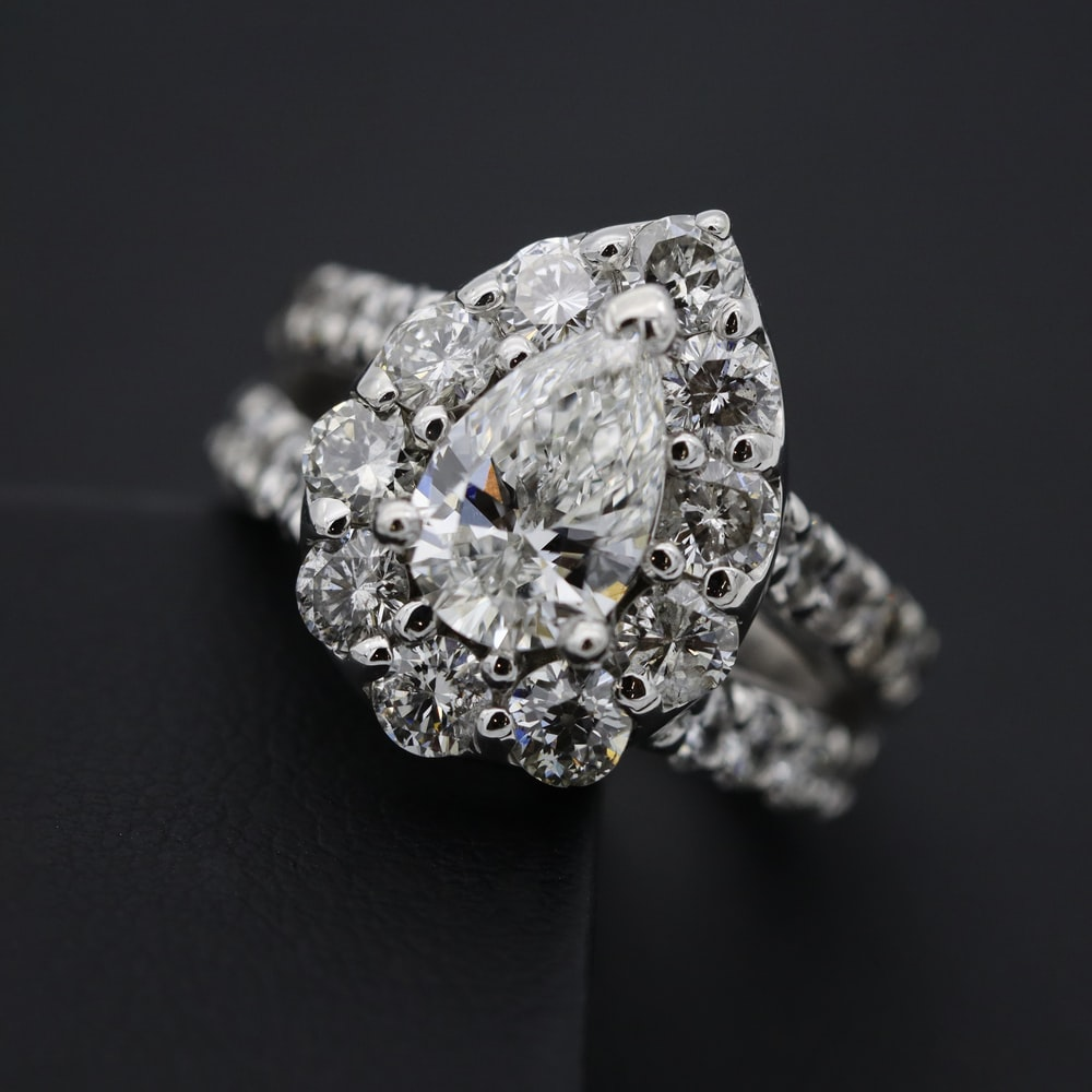 silver diamond studded ring on black textile