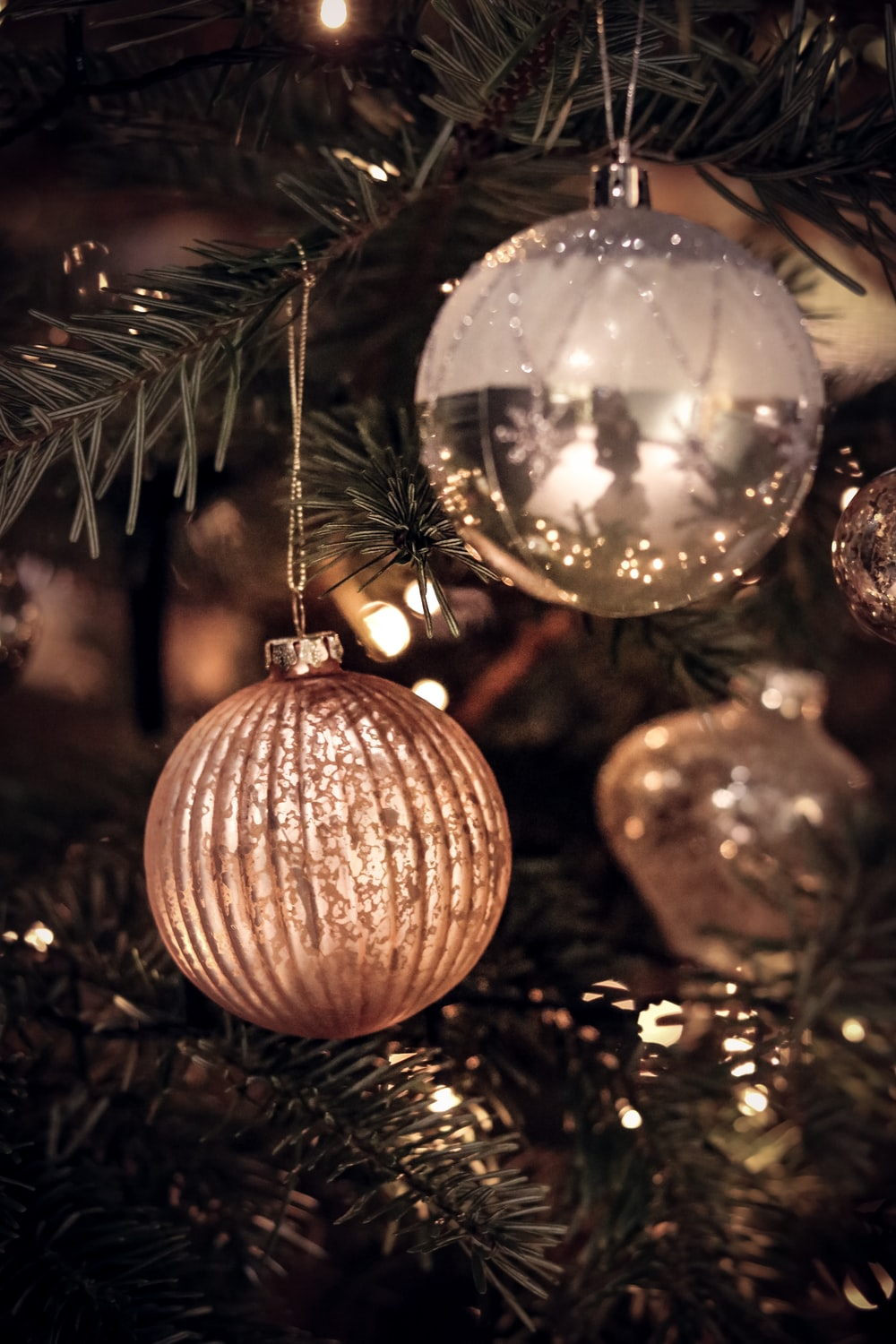 gold bauble on christmas tree