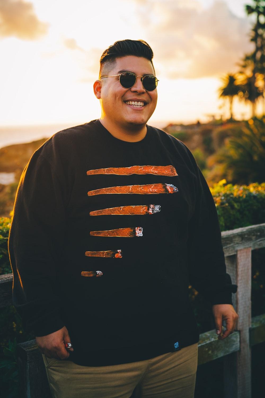 man in black crew neck long sleeve shirt wearing black sunglasses