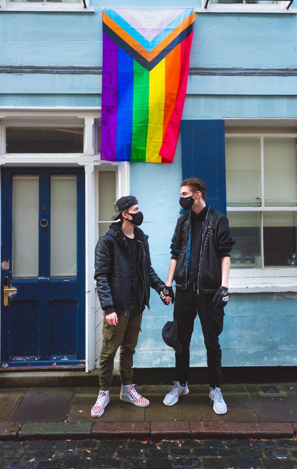 man in black jacket standing beside man in black jacket