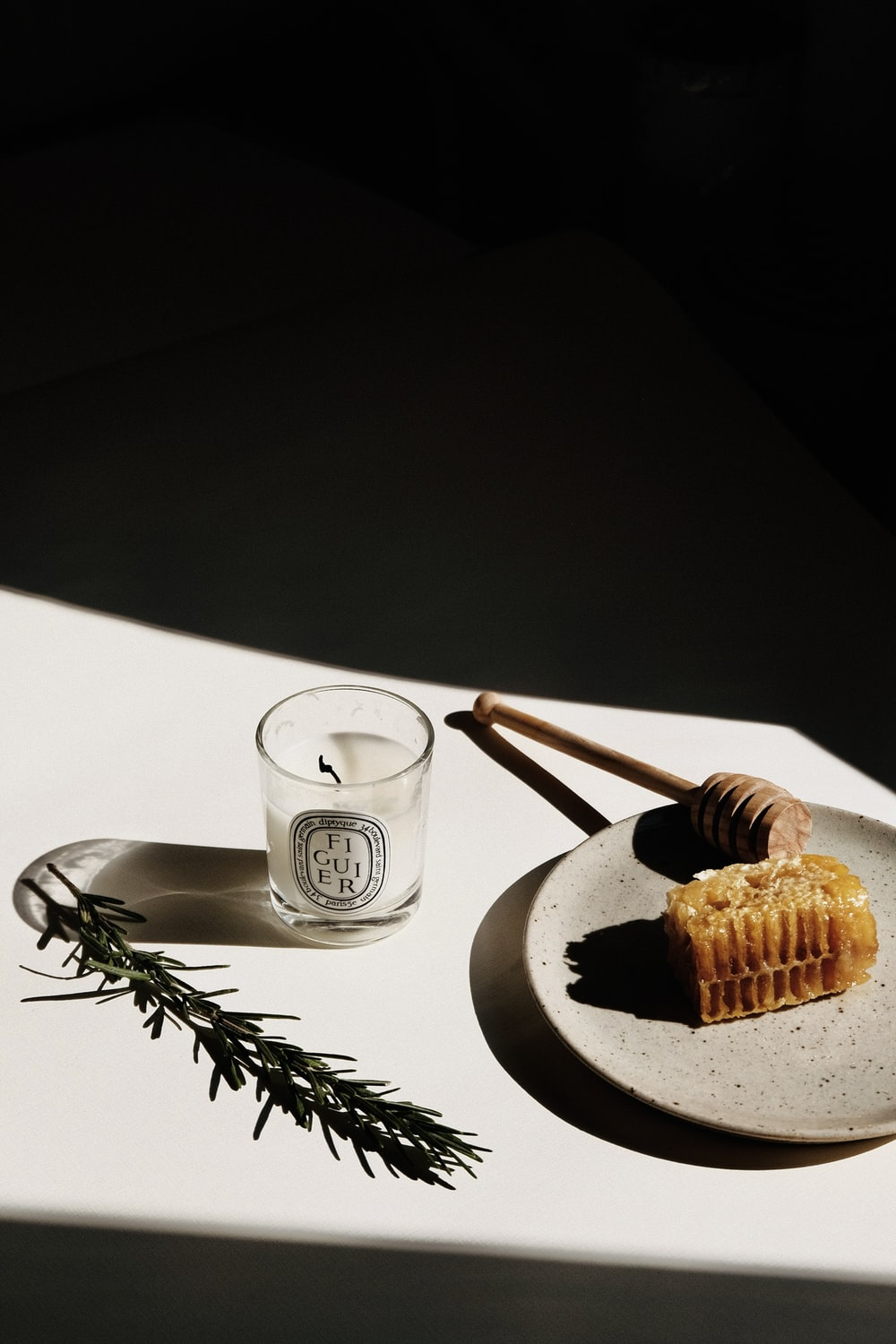 waffle on black plate beside clear drinking glass