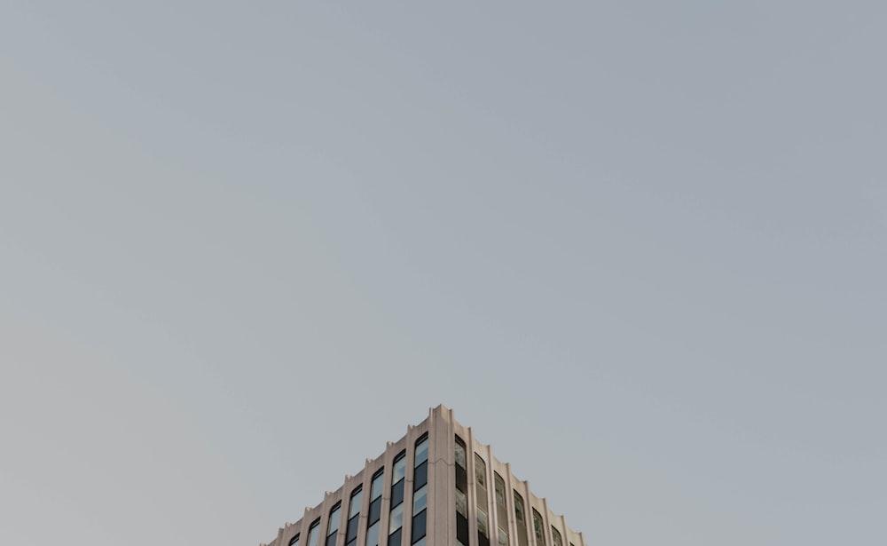 white concrete building under white sky during daytime