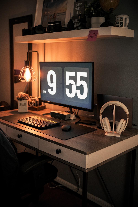 black flat screen tv turned on near white desk fan