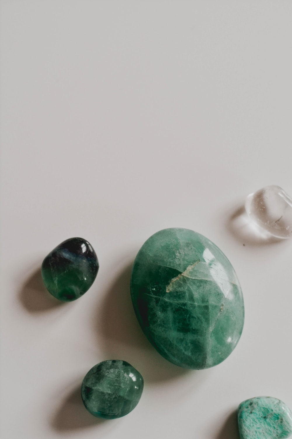green and white marble toys