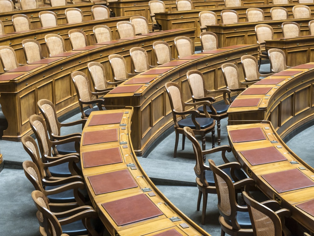 brown wooden chairs on blue and brown wooden floor