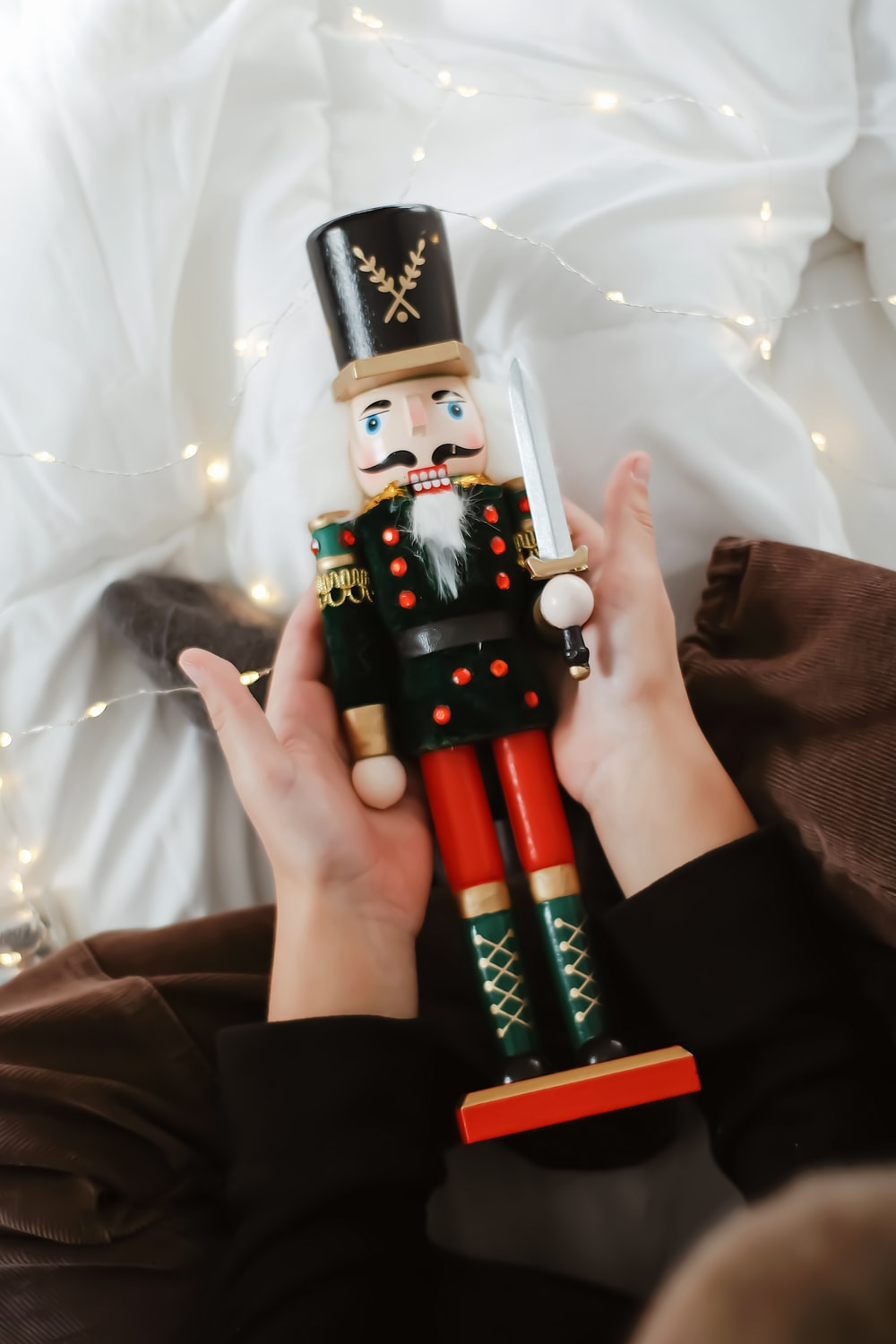 person holding black and white robot toy