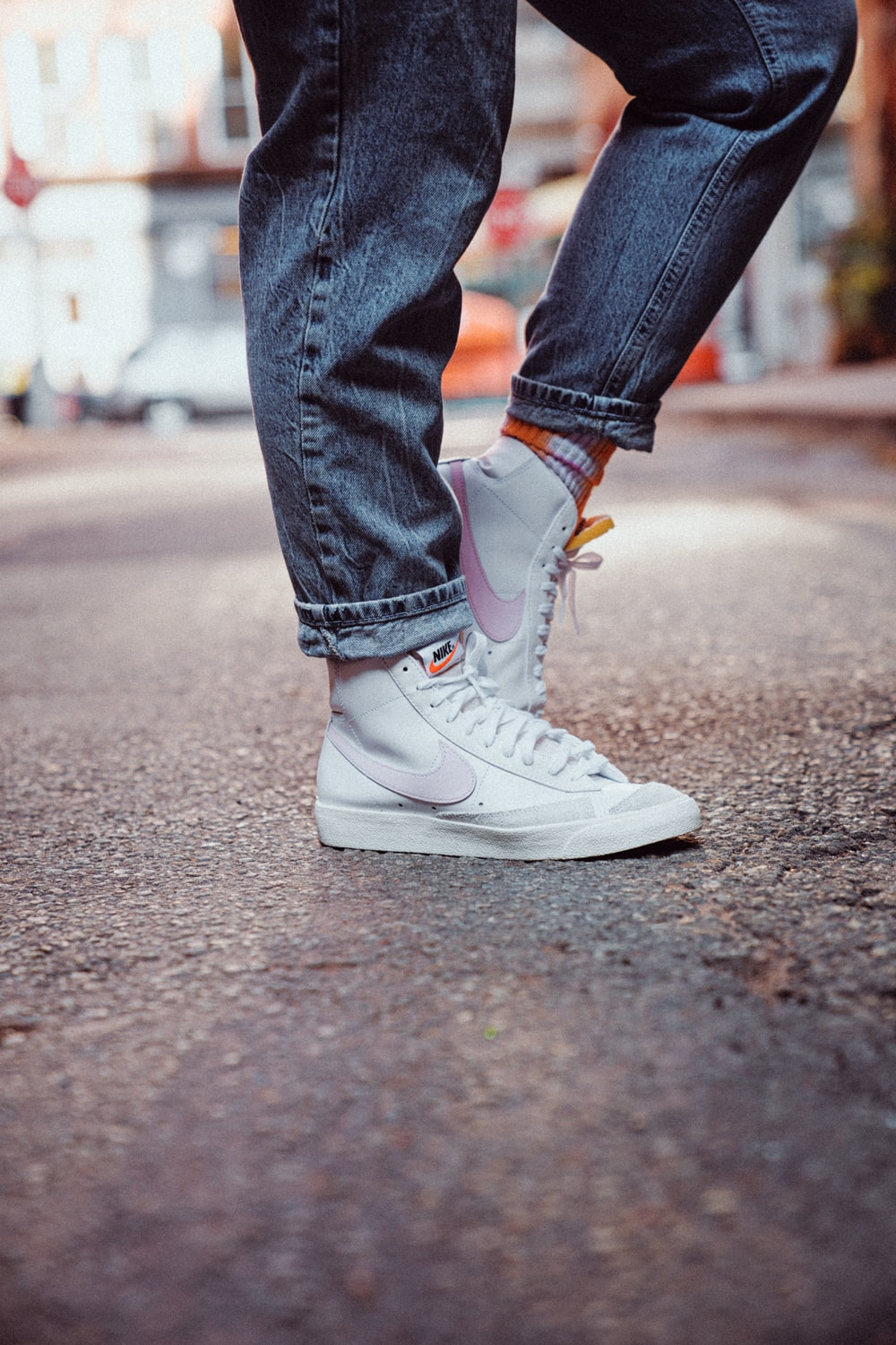 person in blue denim jeans and white nike sneakers