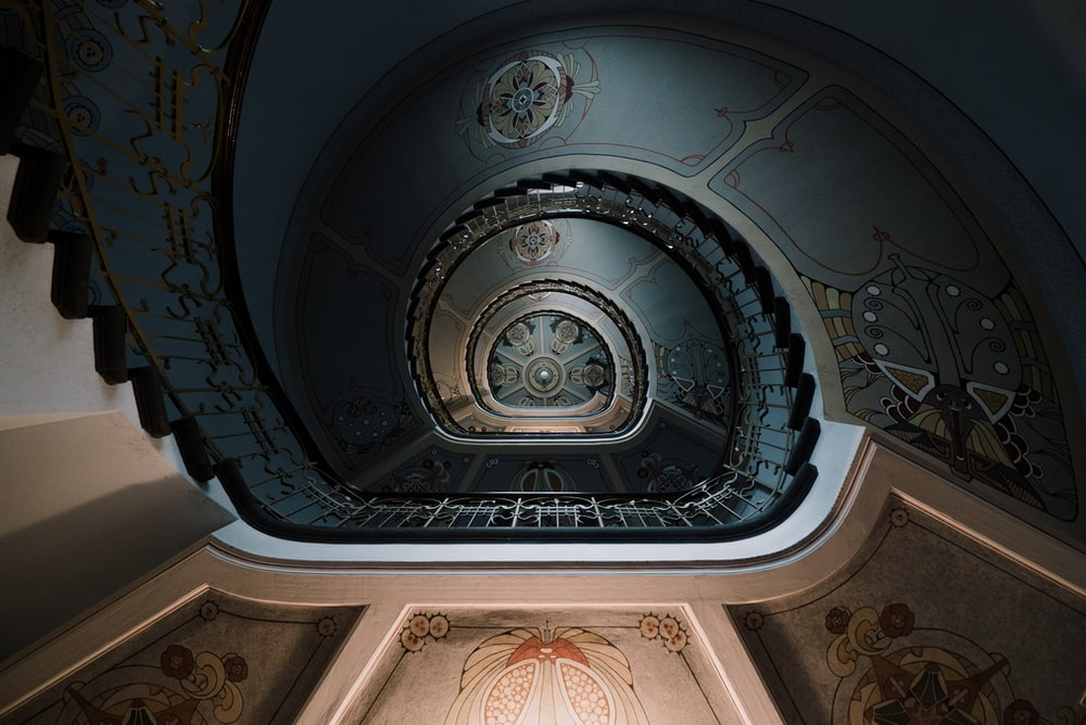 low angle photography of spiral staircase