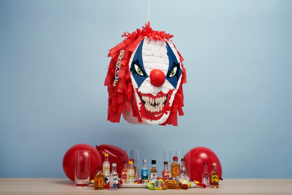 red and white clown mask