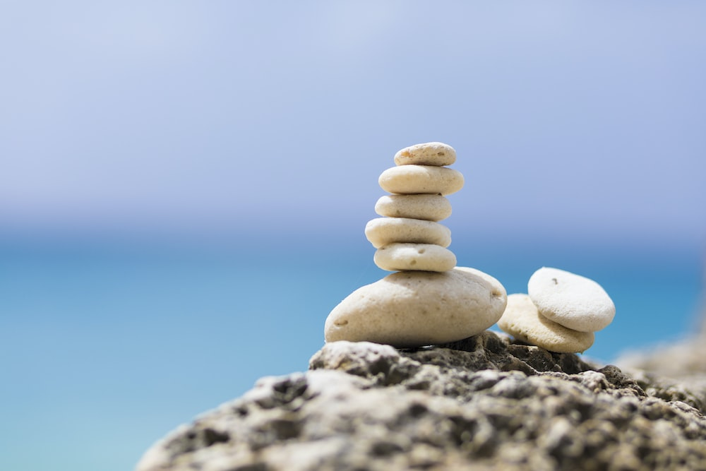 stack of stones on gray rock