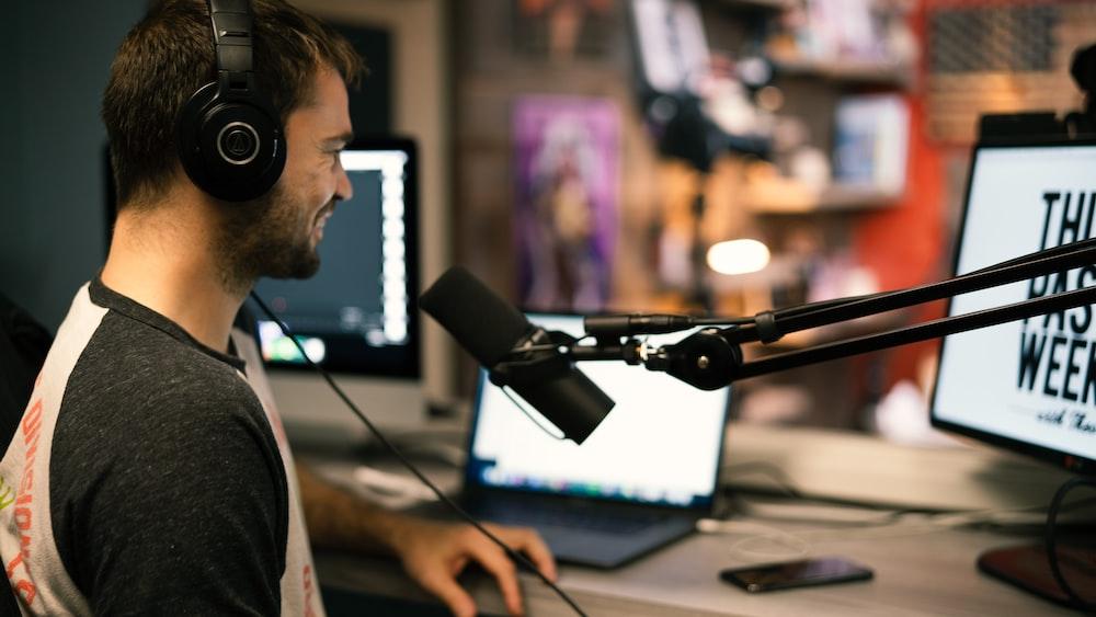 man in gray collared shirt wearing black headphones