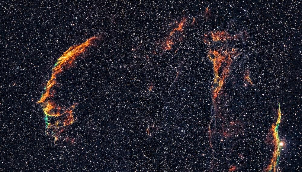 orange and black galaxy illustration