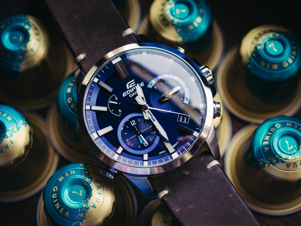 silver and blue round chronograph watch