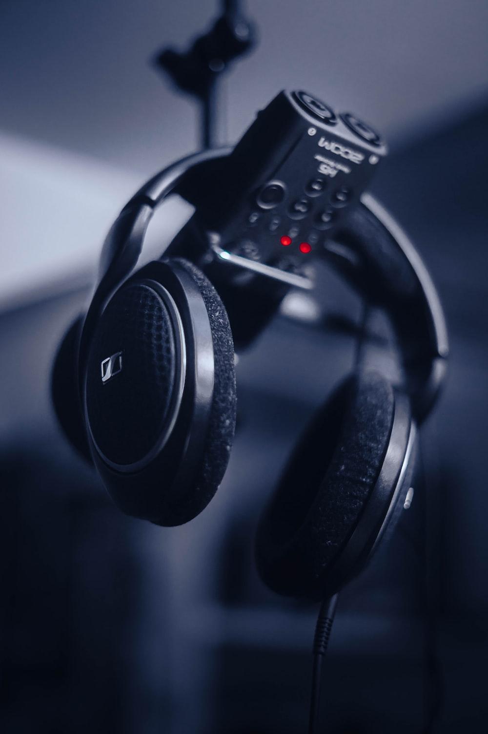 black and gray headphones on black remote control