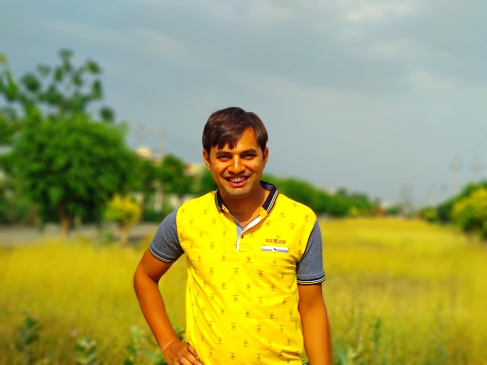 woman in yellow polo shirt standing on green grass field during daytime