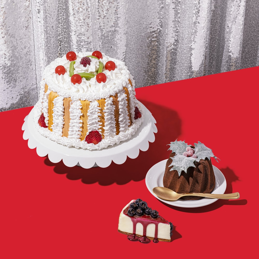 white and brown cake on red table