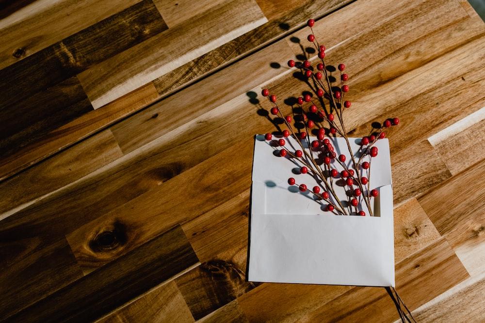 white printer paper on brown wooden parquet floor
