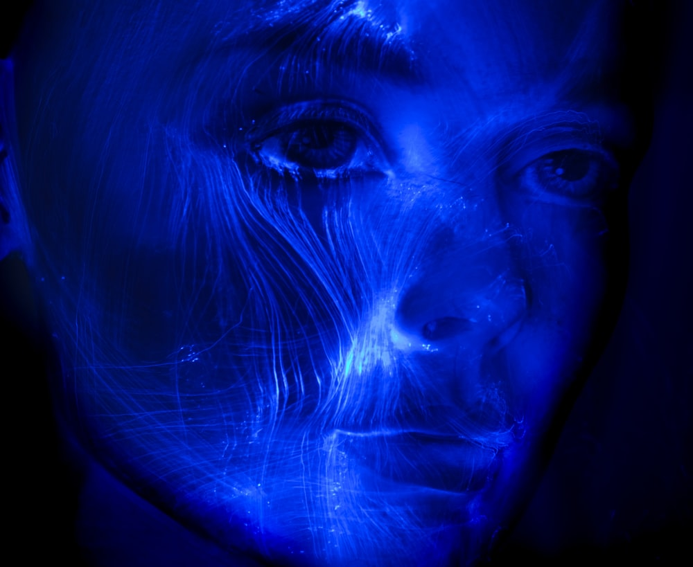 womans face with blue light