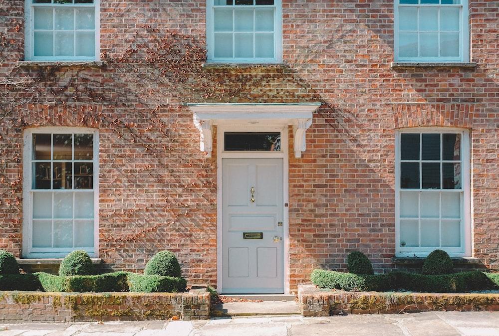 brown brick building with white wooden door