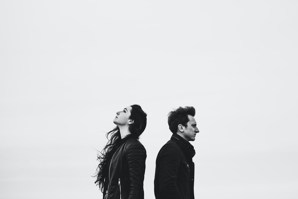 man and woman standing side by side
