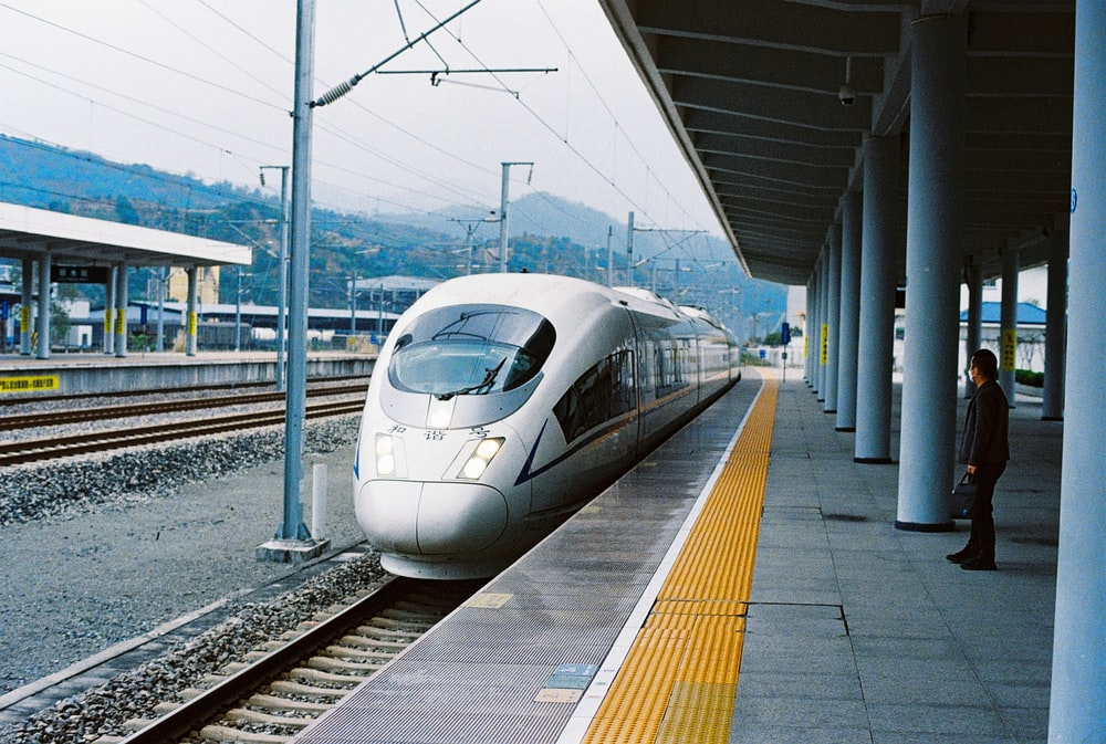 white bullet train on rail way during daytime