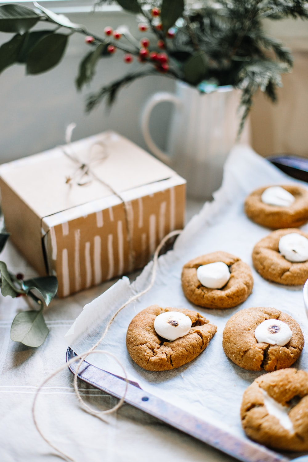 brown and white box with white and brown donuts